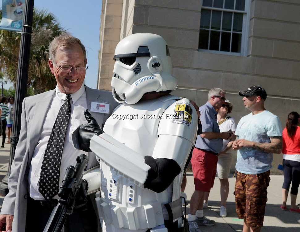 Candidate for NC House District 16 Steve Unger poses with Robert Lentz dressed as a Storm Trooper during a pro film incentives rally Sunday May 4, 2014 in Wilmington, N.C. (Jason A. Frizzelle)