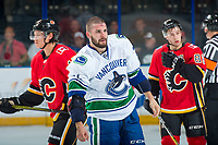 PENTICTON, CANADA - SEPTEMBER 10: Yan-Pavel Laplante #74 of Vancouver Canucks heads to the dressing room after dropping the gloves against the Calgary Flames on September 10, 2017 at the South Okanagan Event Centre in Penticton, British Columbia, Canada.  (Photo by Marissa Baecker/Shoot the Breeze)  *** Local Caption ***