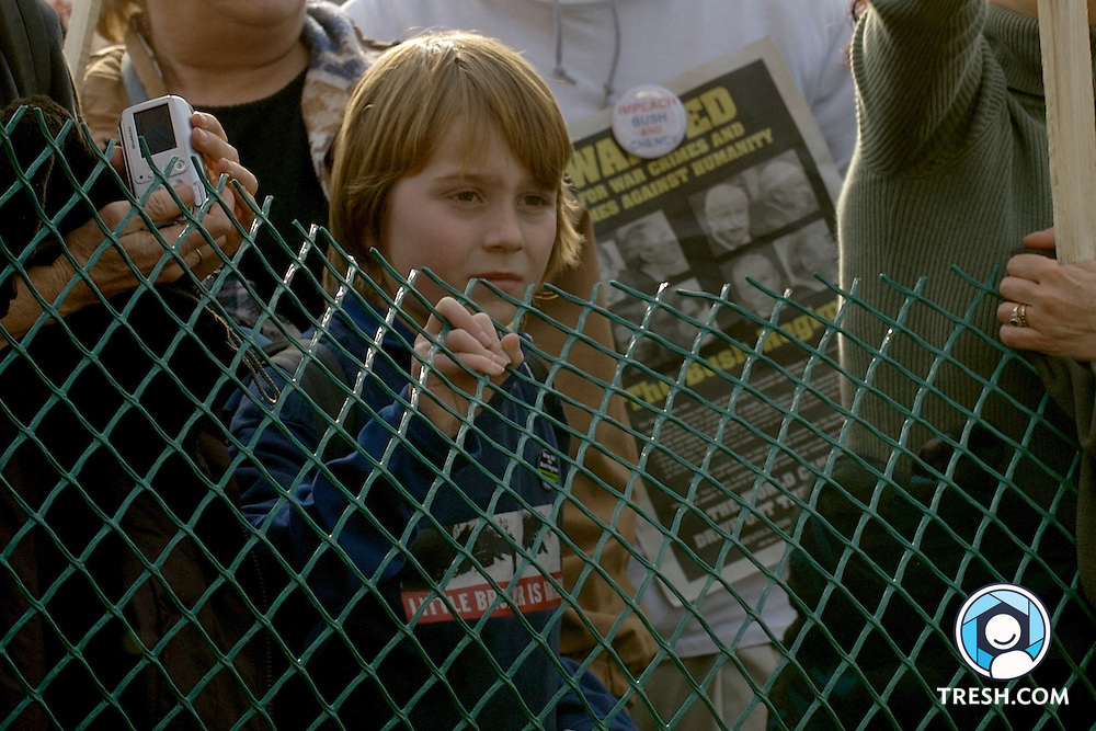 A child watches counter-protesters at the United for Peace and Justice March on Washington to End the Iraq War..