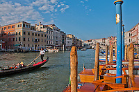 Looking towards the Rialto Bridge along the Grand Canal in Venice, Italy on a beautiful, sunny day.