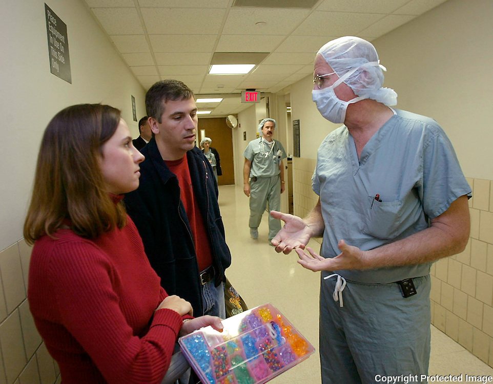 ANNABELLE -- detroit, nov. 7 -- Gina and Nick Costanzo met with surgeon Michael Trese in a hallway at Beumont Hospital in Detroit in 2004 to discuss their daughter Annabelle's operation Friday morning.  photo by david peterson