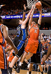 Virginia forward Laurynas Mikalauskas (11) beats Duke center Brian Zoubek (55) to the basket in the first half.  The Virginia Cavaliers men's basketball team fell to the #6 Duke Blue Devils 86-70 at the University of Virginia's John Paul Jones Arena in Charlottesville, VA on March 5, 2008.