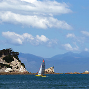 A catamaran on the water near Kaiteriteri is a beautiful seaside resort town in the Nelson region, set close to the Abel Tasman National Park, New Zealand, 3rd February 2011. Photo Tim Clayton..