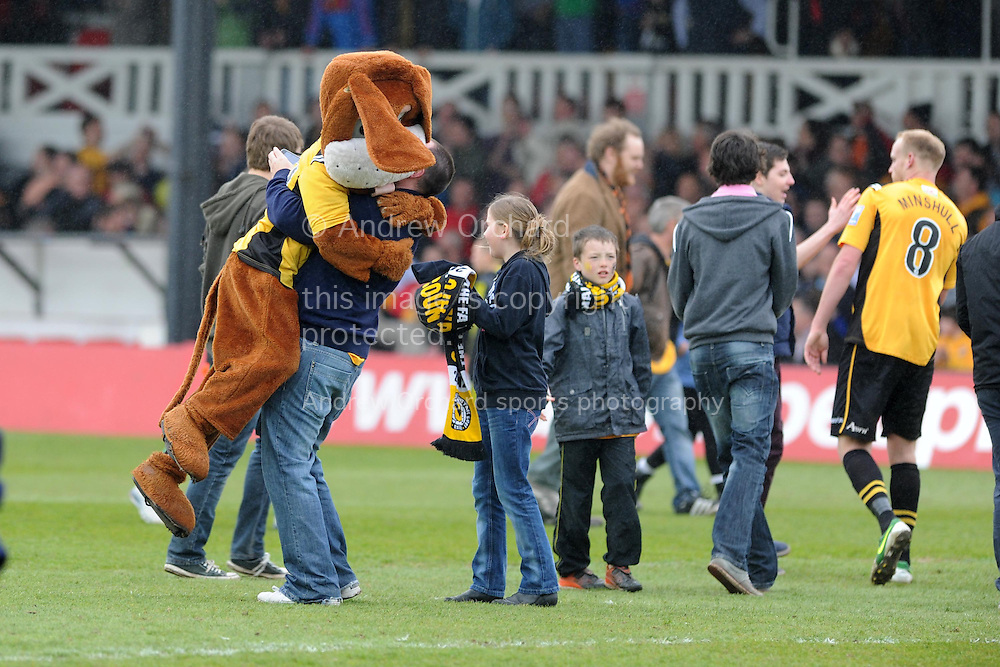 Newport county mascot Spytty the dog celebrates with fans after their win as they book their place in the Wembley final. Blue square bet premier div, play off semi final match, 2nd leg, Newport county v Grimsby Town at Rodney Parade in Newport, South Wales on Sunday 28th April 2013. pic by Andrew Orchard,  Andrew Orchard sports photography,