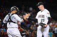 PHOENIX, AZ - JULY 05:  Brad Ziegler #29 of the Arizona Diamondbacks is congratulated by Welington Castillo #7 after closing out the game against the San Diego Padres at Chase Field on July 5, 2016 in Phoenix, Arizona.  The Arizona Diamondbacks won 7-5. (Photo by Jennifer Stewart/Getty Images)