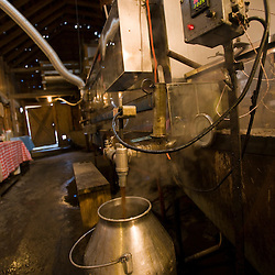 The sap bucket in the sugar house  at Sugarbush Farm in Woodstock, Vermont.