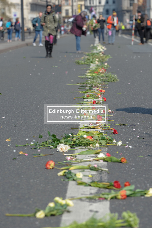 Members of Extinction Rebellion blocked Waterloo Bridge as part of the international rebellion where they will bring London to a standstill for up to two weeks. The group laid flowers along the center of the bridge.  <br /> <br /> Richard Hancox | EEm 15042019
