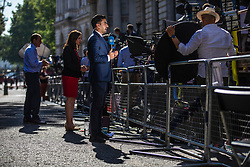 © Licensed to London News Pictures. 23/07/2019. London, UK. Broadcast journalists gathered on Downing Street as Prime Minister Theresa May chairs her final Cabinet meeting. The result of the Conservative Party leadership contest will be announced this morning. Photo credit: Rob Pinney/LNP
