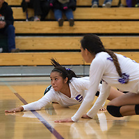 Miyamura Patriot Yael Morgan (5) dives under the ball for a successful pancake to keep it in play during the District Championship game against Aztec Tuesday.