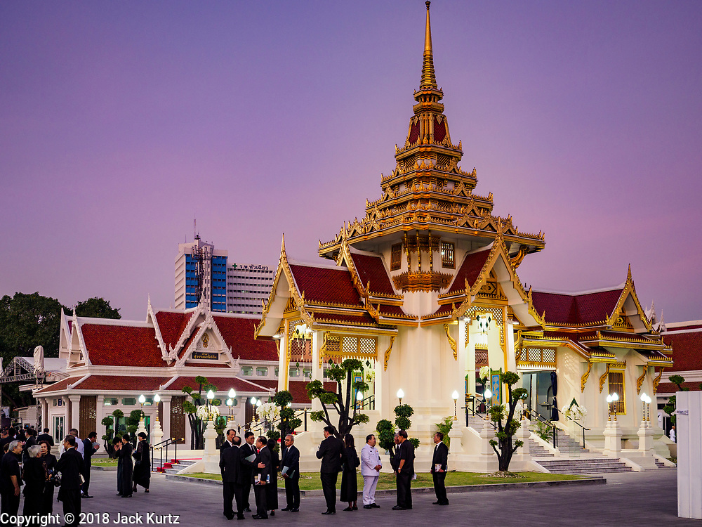 03 NOVEMBER 2018 - BANGKOK, THAILAND: Mourners on the first day of funeral rites for Vichai Srivaddhanaprabha gather in front of the crematorium after bathing rites at Wat Debsirin in Bangkok. Vichai was the owner of King Power, a Thai duty free conglomerate, and the Leicester City Club, a British Premier League football (soccer) team. He died in a helicopter crash in the parking lot of the King Power stadium in Leicester after a match on October 27. Vichai was Thailand's 5th richest man. The funeral is expected to last one week.   PHOTO BY JACK KURTZ