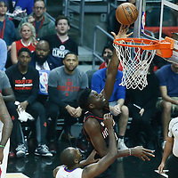 01 March 2017: Houston Rockets center Clint Capela (15) goes for the layup past LA Clippers forward Luc Mbah a Moute (12) during the Houston Rockets 122-103 victory over the LA Clippers, at the Staples Center, Los Angeles, California, USA.
