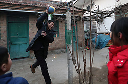 epa05751040 (19/22) Chinese migrant worker Wang Pengfei (C) plays with his son Ruiqi (L) and daughter Yaqin (R) in their home in Heze City, Shandong Province, China, 22 January 2017. Wang is the migrant worker and is working in the capital city as a delivery man. He will travel to visit his family in the Shandong Province for the annual Chinese Lunar New Year or Spring Festival. This is the only time he gets to see his family each year. Wang will join millions of fellow Chinese travelers making their way back home as they pack trains, planes and buses, in what is the largest human migration in the world. The journey, known as 'Chunyun' - the annual spring migration, will involve a total of 2,98 billion trips, starting from 13 January and continuing until 21 February 2017.  EPA/HOW HWEE YOUNG PLEASE REFER TO THE ADVISORY NOTICE (epa05751021) FOR FULL PACKAGE TEXT