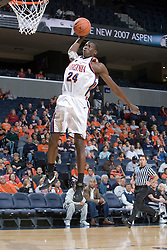 Virginia Cavaliers G/F Mamadi Diane (24) goes up for an uncontested dunk.  The Virginia Cavaliers men's basketball team defeated the Carson-Newman Eagles 124-65 in an exhibition basketball game at the John Paul Jones Arena in Charlottesville, VA on November 4, 2007.