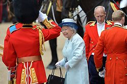 Image ©Licensed to i-Images Picture Agency. 14/06/2014. <br /> <br /> The Queen smiles as she is saluted on her arrival at Horse Guards Parade for the Trooping of the Colour.<br /> <br /> Trooping The Colour, Her Majesty The Queens Birthday Parade at Horse Guards Parade, London, UK.<br /> <br /> Saturday 14th of June 2014.<br /> Picture by Ben Stevens / i-Images