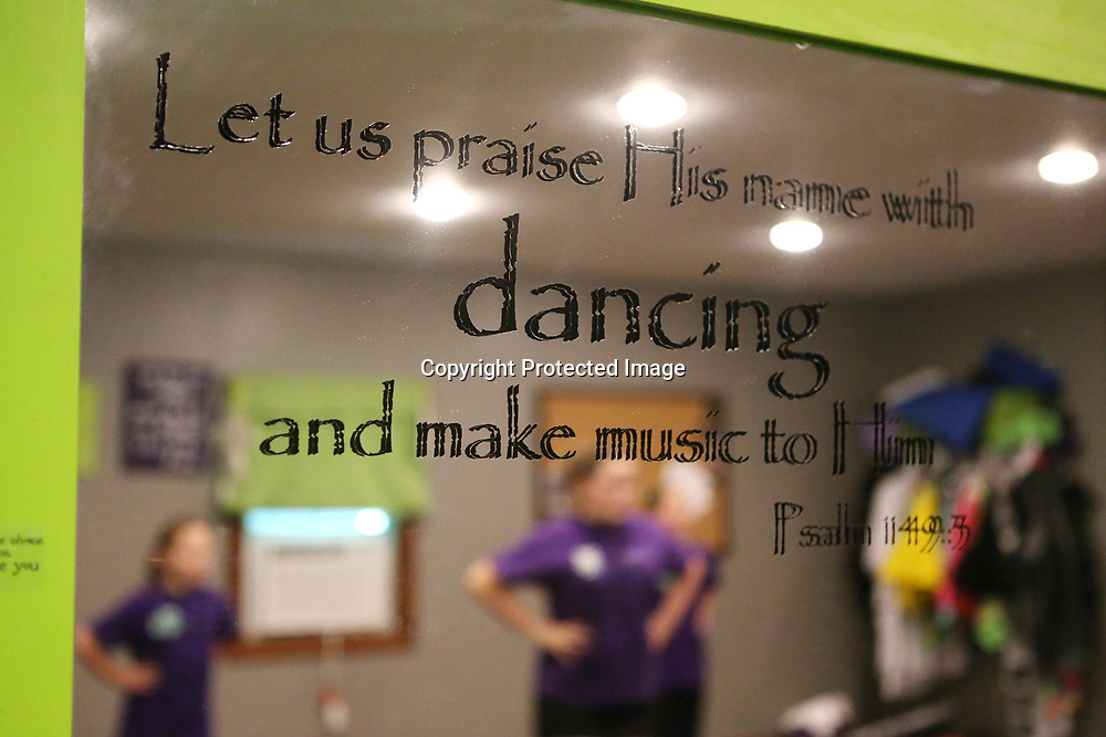 """Bible verse Psalm 149:3 """"Let us praise His name with dancing and make music to Him"""" sticks to the mirror in the Steel Toe Magnolias studio in Amory."""