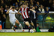 Sheffield United's Chris Basham goes past Kalvin Phillips of Leeds United during the EFL Sky Bet Championship match between Leeds United and Sheffield Utd at Elland Road, Leeds, England on 27 October 2017. Photo by Paul Thompson.