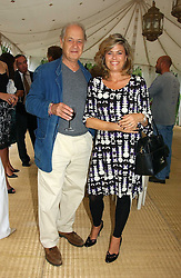 Actor JOHN STANDING and his wife SARAH at a party to celebrate the publication of Notting Hell by Rachel Johnson held in the gardens of 1 Rosmead Road, London W11 on 4th September 2006.<br />