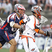 Paul Rabil #99 of the Boston Cannons tries to get the ball from Justin Pennington #14 of the Denver Outlaws during the game at Harvard Stadium on May 10, 2014 in Boston, Massachusetts. (Photo by Elan Kawesch)