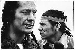 DENNIS BANKS, a co-founder of the American Indian Movement and a leader of the 1973 Wounded Knee occupation, has died, his family announced Monday. He was 80. Banks was one of several activists who founded the American Indian Movement in Minneapolis in 1968, and he was a leader of AIM's armed takeover of Wounded Knee on the Pine Ridge Reservation in South Dakota in 1973, in a protest against both the tribal and U.S. governments. PICTURED: 1973 - Pine Ridge Reservation, South Dakota U.S. - RUSSELL MEANS, left, and DENNIS BANKS, right, at Wounded Knee in March 1973. (Credit Image: © Mike Zerby/TNS via ZUMA Wire)