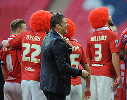 Bristol City manager, Steve Cotterill laughs after getting drenched in champagne - Photo mandatory by-line: Dougie Allward/JMP - Mobile: 07966 386802 - 22/03/2015 - SPORT - Football - London - Wembley Stadium - Bristol City v Walsall - Johnstone Paint Trophy Final