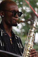 The 12th annual Hyde Park Jazz Festival was held this weekend, Saturday, September 29th and Sunday, September 30th, 2018 at various venues around Hyde Park. Jazz musicians from all around came out to play at the two-day event. <br /> <br /> 2967, 2972, 2986, 2987 - Isaiah Collier and the Chosen Few played the Wagner Stage Saturday afternoon on the Midway Plaisance located at 1130 Midway Plaisance on the University of Chicago campus.<br /> <br /> Please 'Like' &quot;Spencer Bibbs Photography&quot; on Facebook.<br /> <br /> Please leave a review for Spencer Bibbs Photography on Yelp.<br /> <br /> Please check me out on Twitter under Spencer Bibbs Photography.<br /> <br /> All rights to this photo are owned by Spencer Bibbs of Spencer Bibbs Photography and may only be used in any way shape or form, whole or in part with written permission by the owner of the photo, Spencer Bibbs.<br /> <br /> For all of your photography needs, please contact Spencer Bibbs at 773-895-4744. I can also be reached in the following ways:<br /> <br /> Website &ndash; www.spbdigitalconcepts.photoshelter.com<br /> <br /> Text - Text &ldquo;Spencer Bibbs&rdquo; to 72727<br /> <br /> Email &ndash; spencerbibbsphotography@yahoo.com<br /> <br /> #SpencerBibbsPhotography #HydePark #Community #Neighborhood<br /> #Music<br /> #HydeParkJazzFestival<br /> #Jazz<br /> #LiveMusic<br /> #IsaiahCollier
