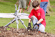 Matthew Bowser, 11 helps plant flowers during a cleanup of the Victory Oak Knoll Memorial near the entrance of Dayton's Community Golf Course (at the edge of Kettering) by Boy Scout Troop 193, Saturday, May 7, 2011.
