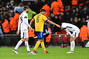 Sami Khedira (6) of Juventus goes to Heung-Min Son (7) of Tottenham Hotspur who is bent over in despair at full time after Juventus won 2-1 on the night and 4-3 on aggrigate during the Champions League match between Tottenham Hotspur and Juventus FC at Wembley Stadium, London, England on 7 March 2018. Picture by Graham Hunt.