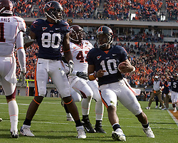 Virginia quarterback Jameel Sewell (10) scores his first of two rushing touchdowns.  The #8 ranked Virginia Tech Hokies defeated the #16 ranked Virginia Cavaliers 33-21 at Scott Stadium in Charlottesville, VA on November 24, 2007.