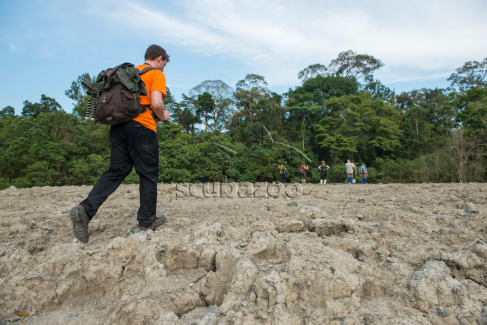 People at a mud volcano, Tabin Wildlife Reserve, Sabah, Malaysia, Borneo,