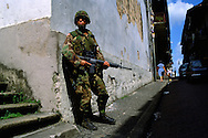 A US soldier patrols on foot as the Americans work to secure Panama City from Panamanian army troops loyal to General Manuel Noriega during the US invasion of Panama, December 1989.