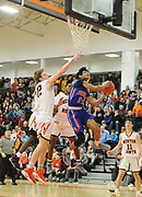 Newton South senior Salman Cheema goes to the basket during the game against Newton North at Newton North, Dec. 27, 2018.   [Wicked Local Photo/James Jesson]