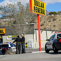 110114       Cable Hoover<br /> <br /> Gallup Police tape off a crime scene at the Dollar General store on South Second Street in Gallup Saturday.