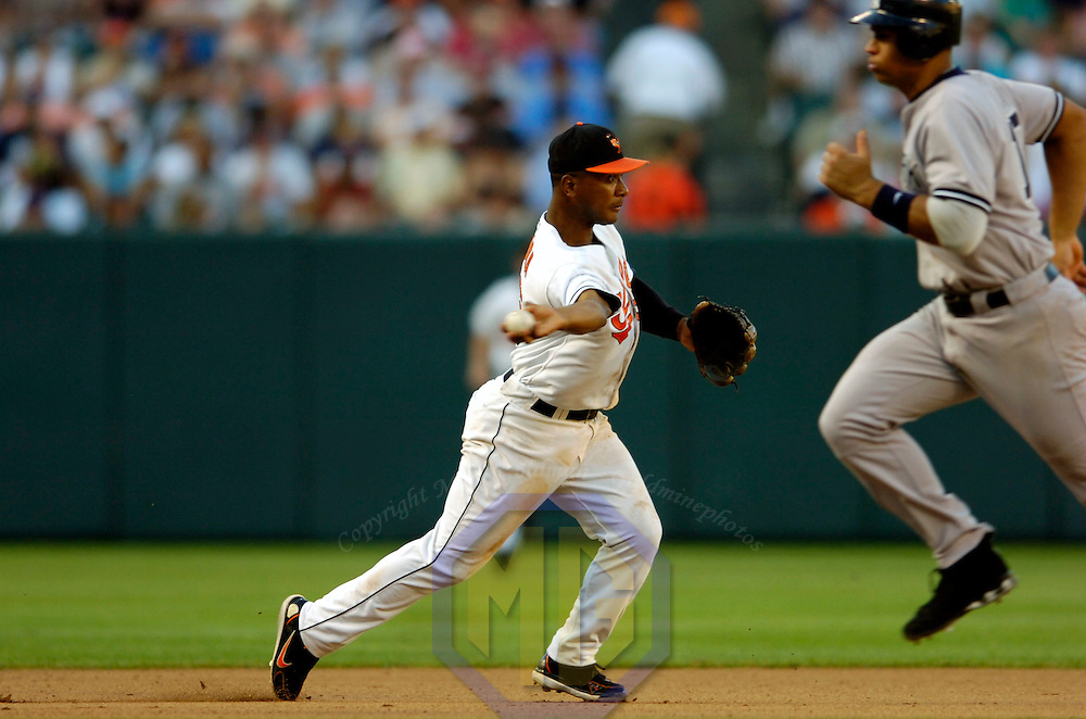 05 August 2006:  The Baltimore Orioles Melvin Mora (6) makes a throw to second on a fielders choice in the 5th inning on a ball hit by the New York Yankees Craig Wilson.  The Orioles defeat the Yankees on a one hit shutout 5-0 at Orioles Park at Camden Yards in Baltimore, MD.