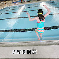 Adam Robison | BUY AT PHOTOS.DJOURNAL.COM<br /> Lily Morris, 8, of Aberdeen, jumps in the pool at the Aquatic Center during her PE time Tuesday.