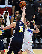 Denver Nuggets center Nikola Jokic #15 fouls LA Clippers guard Milos Teodosic #4 in the 4th quarter. The Los Angeles Clippers defeated the  Denver Nuggets 109-104 at Staples Center in Los Angeles, CA 1/017/2018 (Photo by John McCoy, Los Angeles Daily News/SCNG)