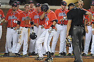 Mississippi's Tim Ferguson (4) hits a two run home run in the fourth inning vs. St. John's during an NCAA Regional at Davenport Field in Charlottesville, Va. on Friday, June 4, 2010.