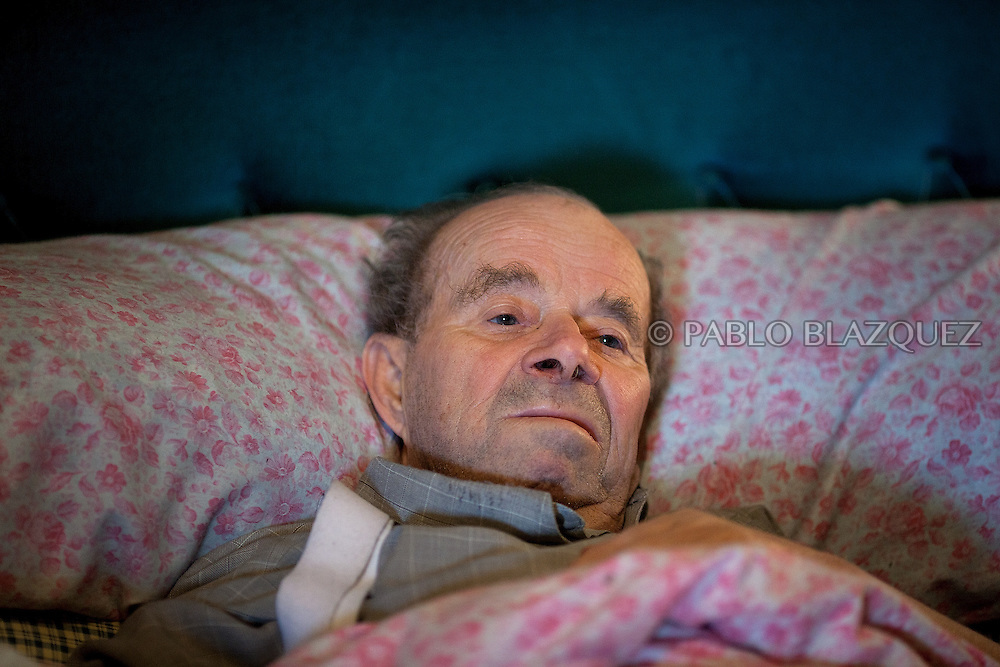 Vicente stays in bed before Court officials and Citibank representative arrive to evict him , on April 18 2012, in Madrid, Spain. Spanish Vicente Torres, 73, who is severely ill and underwent a recent heart surgery, and is waiting for a thrombus surgery faces an eviction from his house after he endorsed his son, so Citibank would concede a credit to buy a house. His son already handed his house to the bank. Torres has lived at his home for the last 55 years and was paying it for 30 years. Eviction procedures in Spanish courts for unpaid mortgages and rent hit a record of 58,241 in 2011, a 21.2 percent rise over the previous year. Evictions have soared in Spain since the collapse of a property bubble in 2008 that triggered the country's economic crisis.