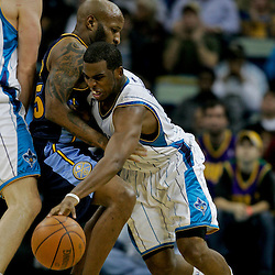 Dec 18, 2009; New Orleans, LA, USA;  New Orleans Hornets guard Chris Paul (3) drives in against Denver Nuggets guard Anthony Carter (25) during the second half at the New Orleans Arena. The Hornets defeated the Nuggets 98-92. Mandatory Credit: Derick E. Hingle-US PRESSWIRE
