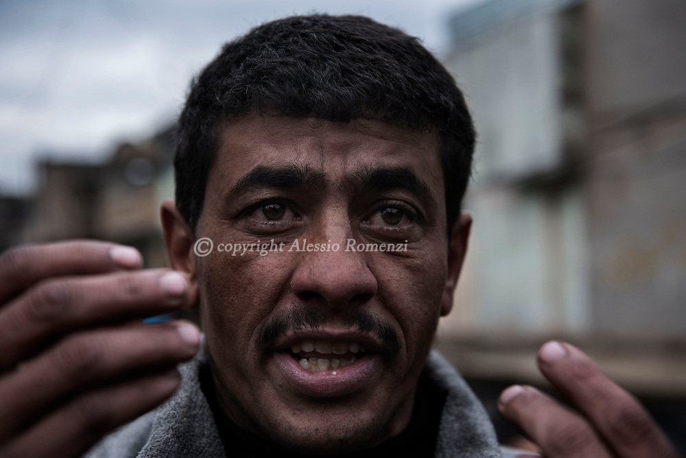 Iraq, Mosul: An Iraqi Mosul resident reacts and gestures while explaining that more the 20 members of his family has been killed by airstrikes in their house nearby the train station in west Mosul. Alessio Romenzi