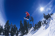 Person on snowboard jumping