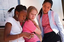 Group of teenage girls at bus stop.