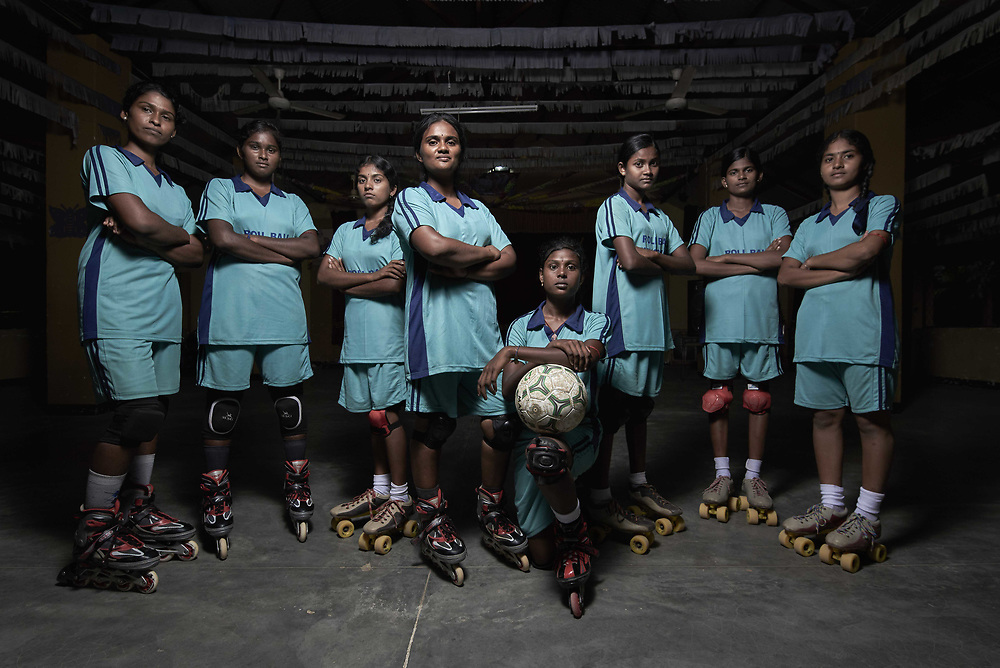 """These girls from Kilinochchi Hindu Vidyalaya form one of the nation's best roll ball teams. Their captain and vice-captain also represent Sri Lanka in roll ball, a rather uncommon sport that is played with a basketball and on roller-blades. While the sport has not spread in popularity in the rest of the country, it has gained traction in the north. These girls whirl and whizz about on their wheels, passing the ball around in effortless style inside the school auditorium, which turns into an improvised roll ball court in the evenings. The auditorium acts as a facility for roll ball practice for more schools in the area, substituting for an actual roll ball court. The girls love the sport and are dedicated to it. """"We love roll ball. It's great fun to move so fast and experience the adrenaline rush. It's scary sometimes, but the excitement brings out the best out of us and we are confident that we can compete with the best schools in the country."""" © Reza Akram / DFAT 2017"""