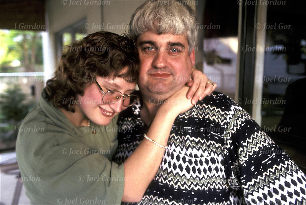 Married developmental disabled couple showing romantic affection....release # 558, 559