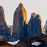 Gigantic granite monoliths shaped by the forces of glacial ice known as the three Towers of Paine in Torres del Paine National Park, Chile.