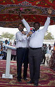 British peer, Lord Ahmed of Rotherham holds microphones for Dr Bakri, the Chancellor of Khartoum University, under a canopy for speakers in Al Fashir, north Darfur. Nazir, Baron Ahmed (born 1958) is a member of the House of Lords, having become the United Kingdom's first Muslim life peer in 1998 and is in this war-torn province of Sudan to attend the first-ever international Conference on Womens' Challenge in Darfur, hosted by the govenor in his own compound.