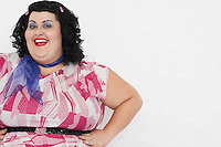 Overweight Woman posing with hands on hips portrait