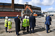 Council Leader Stephen Alambritis (far left) AFC Wimbledon legend Ian Cooke (centre left), AFC Wimbledon legend Dave Bassett (centre right), Chief Executive Erik Samuelson and children from both Smallwood Primary School and children from AFC Wimbledon player development programme during the AFC Wimbledon Demolition Event, marking the start of building works at the AFC Wimbledon Stadium Site, Plough Lane, United Kingdom on 16 March 2018. Picture by Stephen Wright.