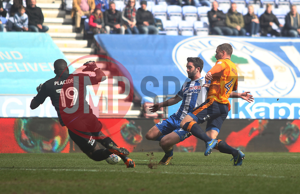 Will Grigg of Wigan Athletic (C) scores his sides first goal - Mandatory by-line: Jack Phillips/JMP - 30/03/2018 - FOOTBALL - DW Stadium - Wigan, England - Wigan Athletic v Oldham Athletic - Football League One