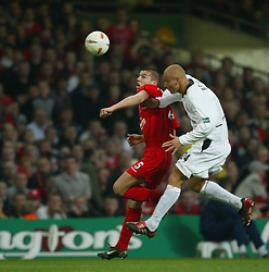 CARDIFF, WALES - Sunday, March 2, 2003: Liverpool's Milan Baros and Manchester United's Wes Brown during the Football League Cup Final at the Millennium Stadium. (Pic by David Rawcliffe/Propaganda)