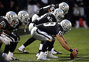 Oakland Raiders long snapper Jon Condo (59) gets set to snap the ball while warming up before the NFL week 12 regular season football game against the Kansas City Chiefs on Thursday, Nov. 20, 2014 in Oakland, Calif. The Raiders won their first game of the season 24-20. ©Paul Anthony Spinelli